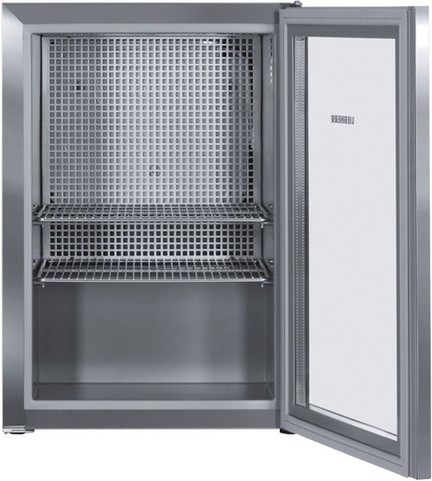 Стильный и вместительный бытовой холодильник для косметики с полками решетками металлического цвета