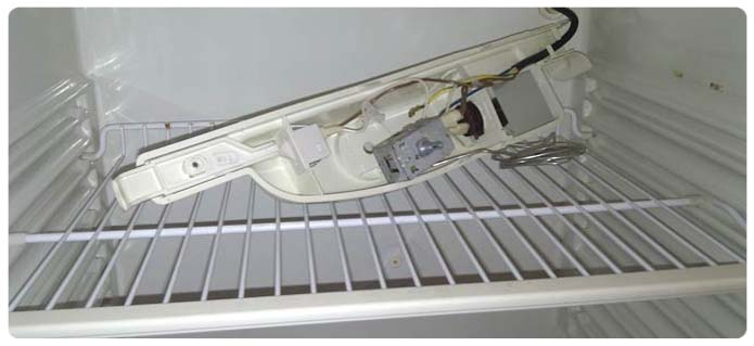 Открутите и достаньте терморегулятор